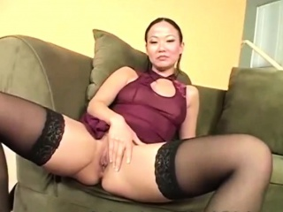 Asian hottie makes the brush..